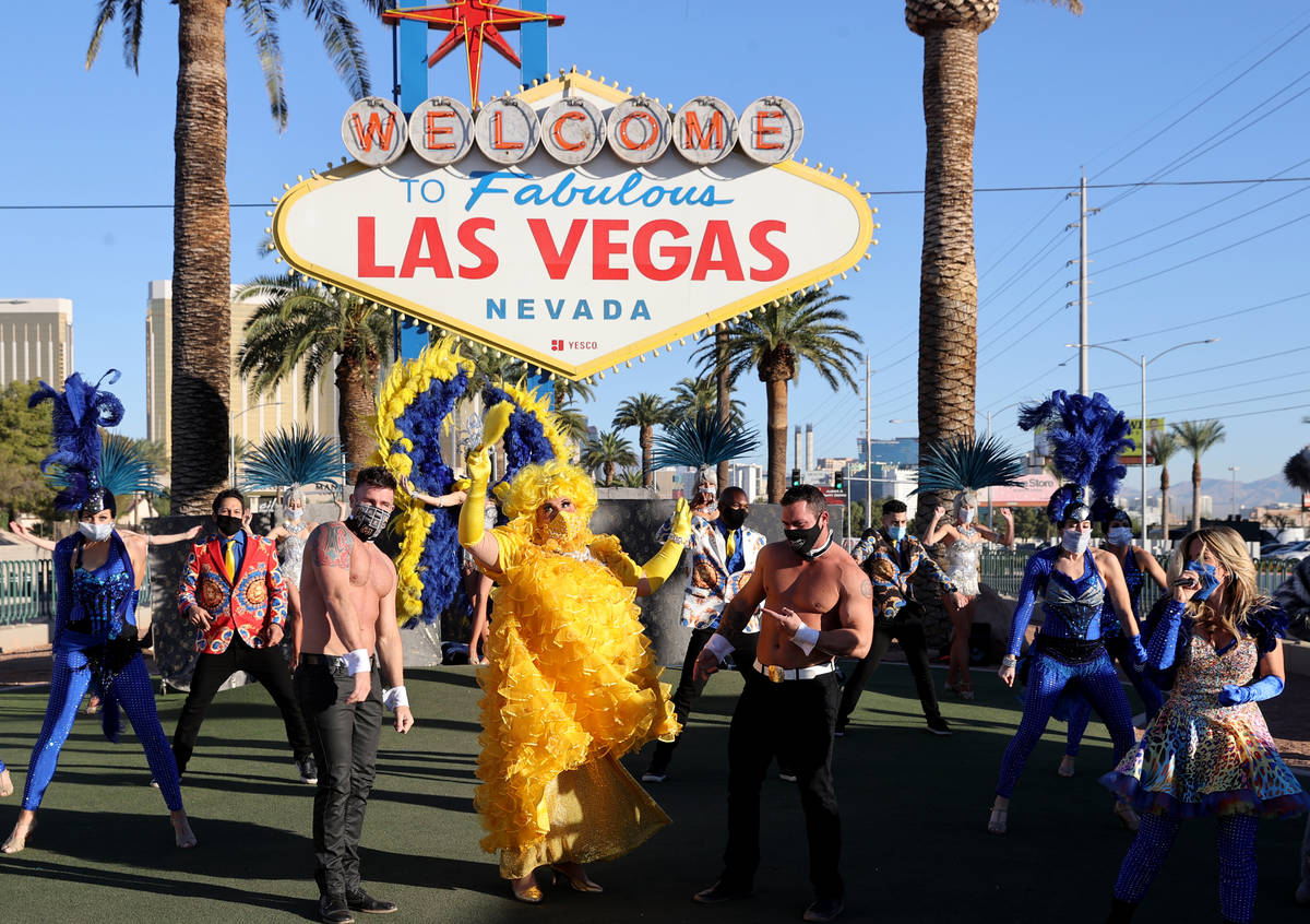 """Las Vegas performers, including Jim """"Auntie Norma Llyaman"""" McCoy, front, people kick off a mult ..."""