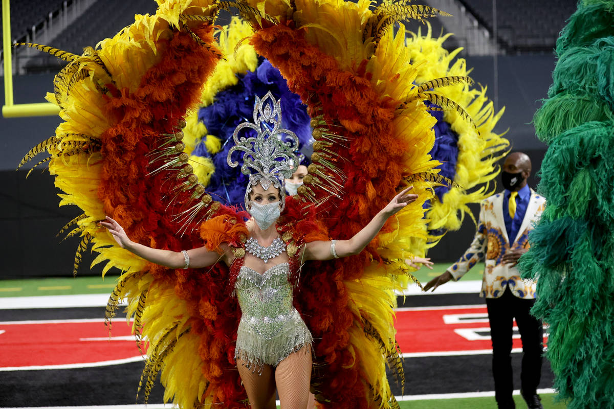 Las Vegas performers, including Jennifer Jordan, front, put on a show at Allegiant Stadium as p ...