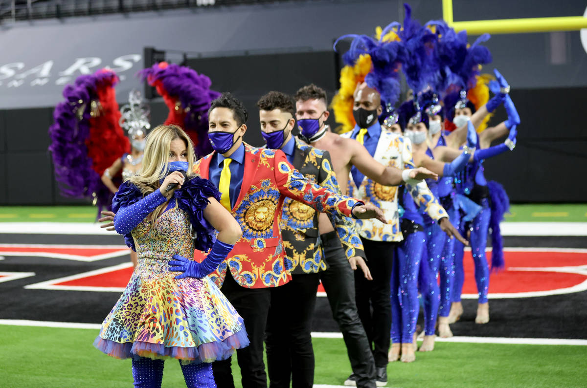 Las Vegas performers, including Lily Arce, left, put on a show at Allegiant Stadium as part of ...