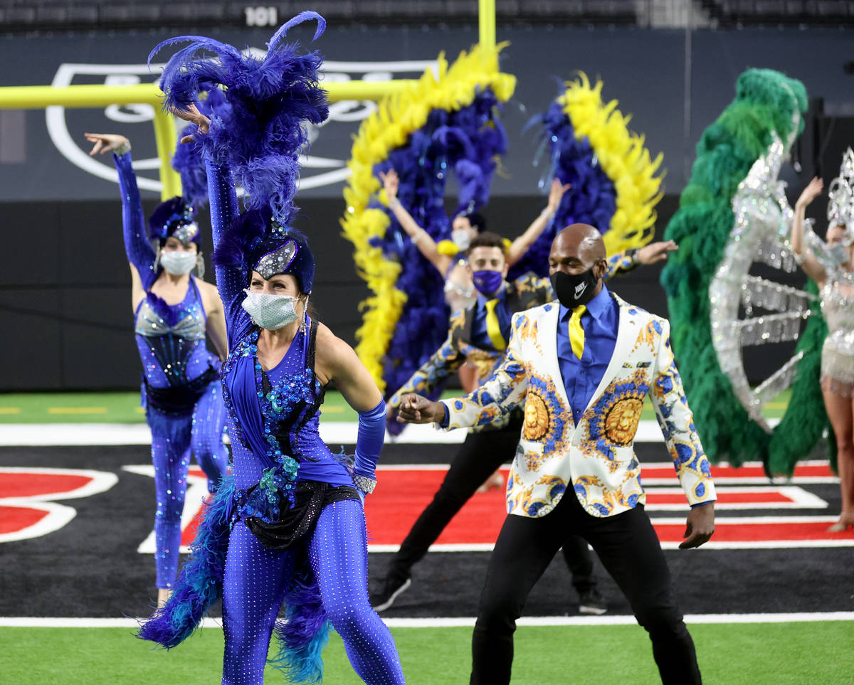 Las Vegas performers, including Chelsea Dee, front, put on a show at Allegiant Stadium as part ...