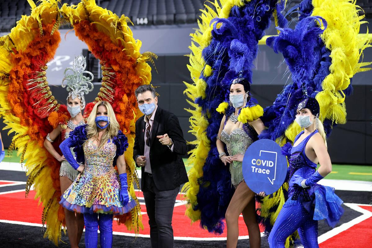 John Katsilometes, center, poses with Las Vegas performers, from left, Jennifer Jordan, Lily Ac ...
