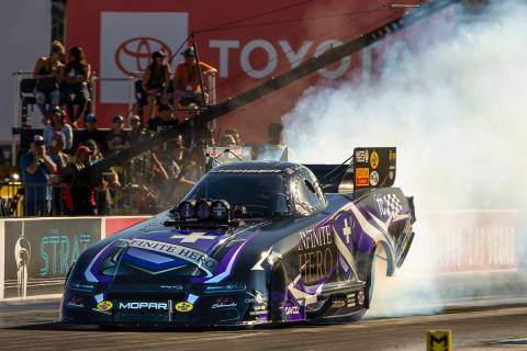 Funny Car racer Jack Beckman burns his tires during the second round of the Dodge NHRA National ...