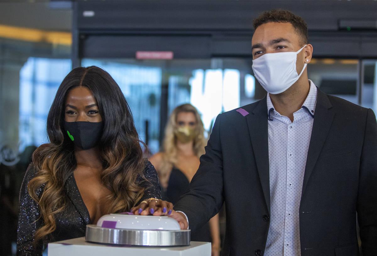Love Island 2 winners Justine Ndiba, center left, and Caleb Corprew, fire off confetti during t ...