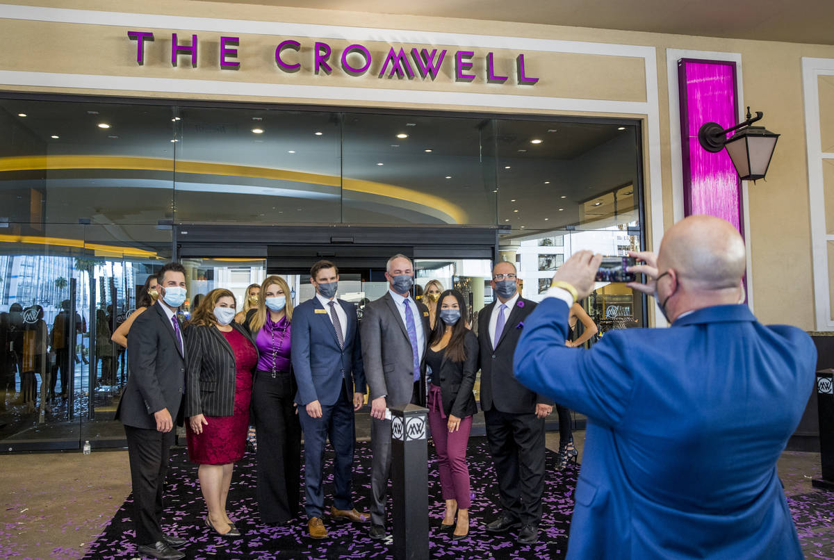 Staff gather to document the day out front following the reopening celebration for the The Crom ...