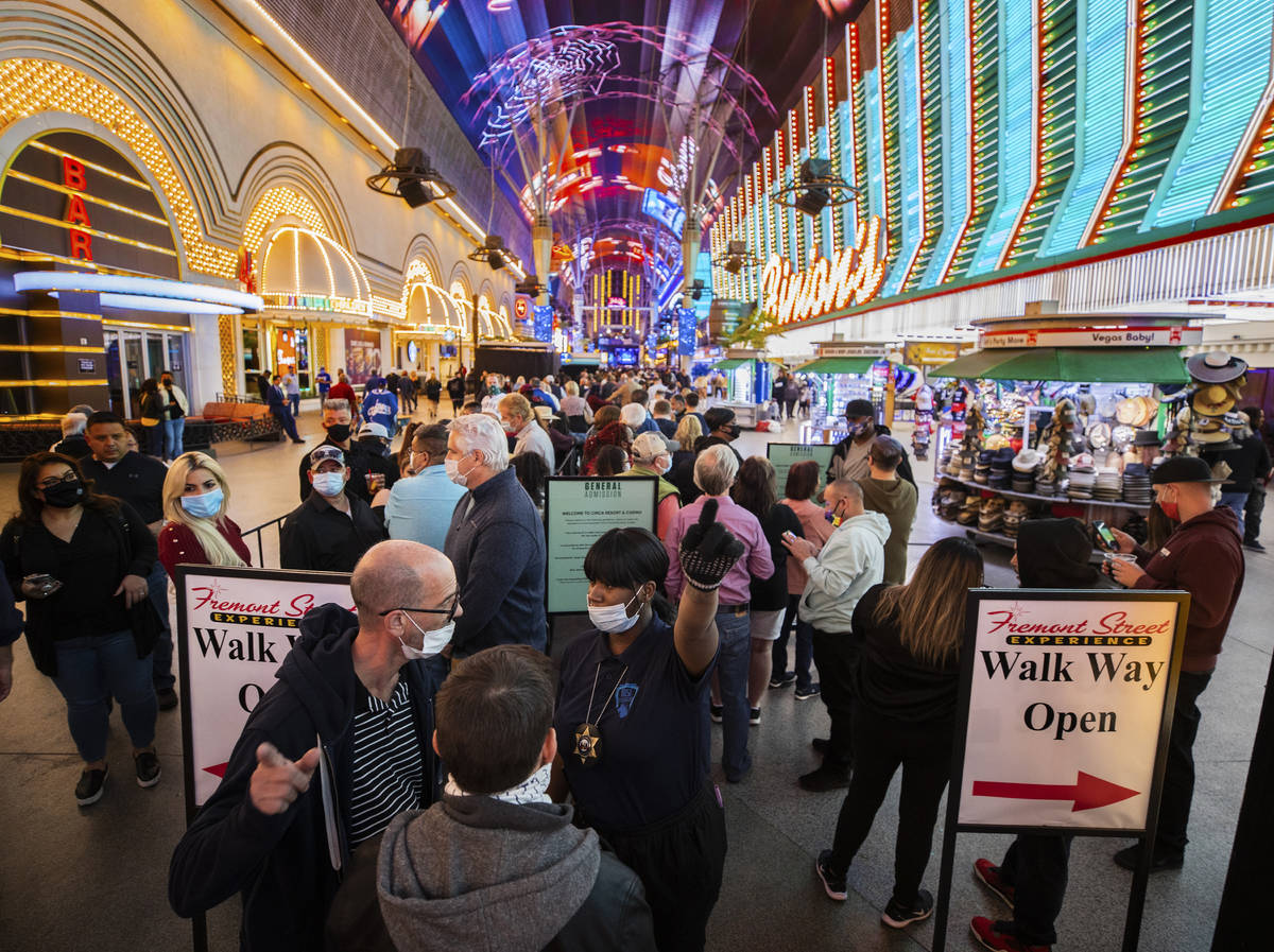 People wait in line for blocks at the Fremont Street Experience to enter Circa during the resor ...