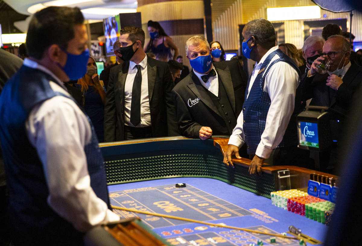 Circa owner Derek Stevens checks on a craps table shortly before the first roll of the dice dur ...