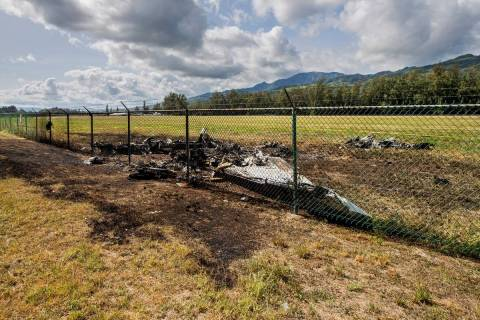 The charred remains of a skydiving plane that crash on Oahu's North Shore are shown near Waialu ...