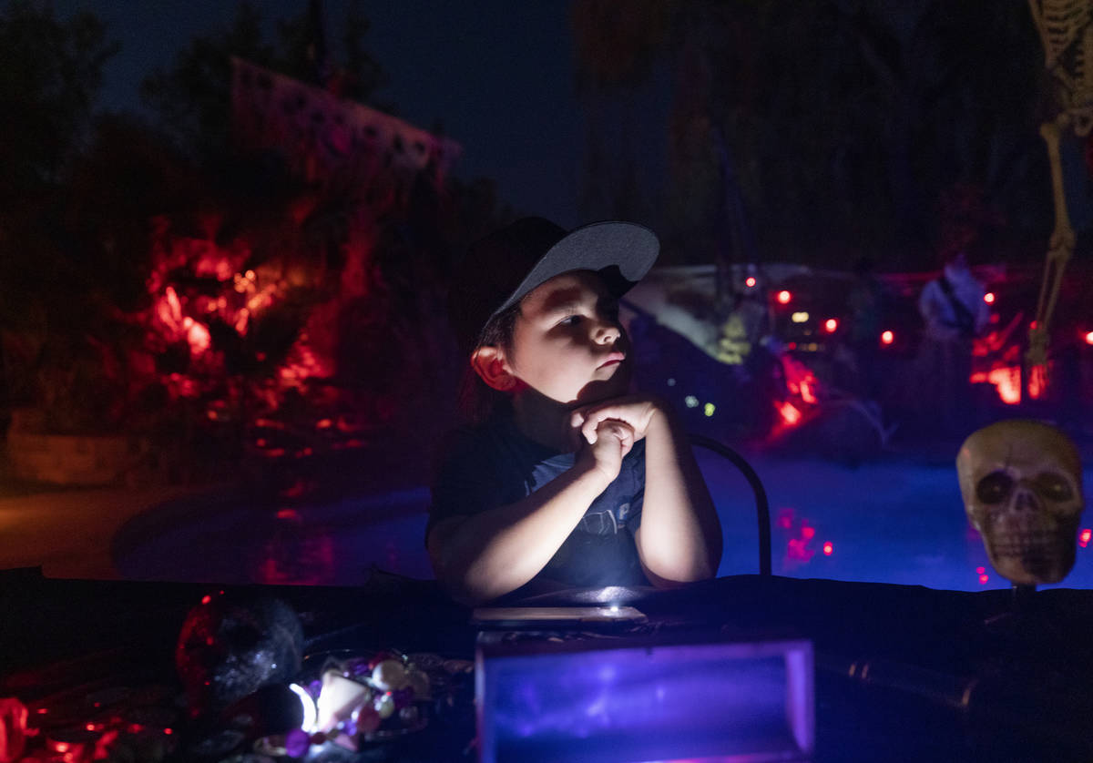 Logan Garcia, 6, sits at a table in his backyard that is decorated like The Pirates of the Car ...