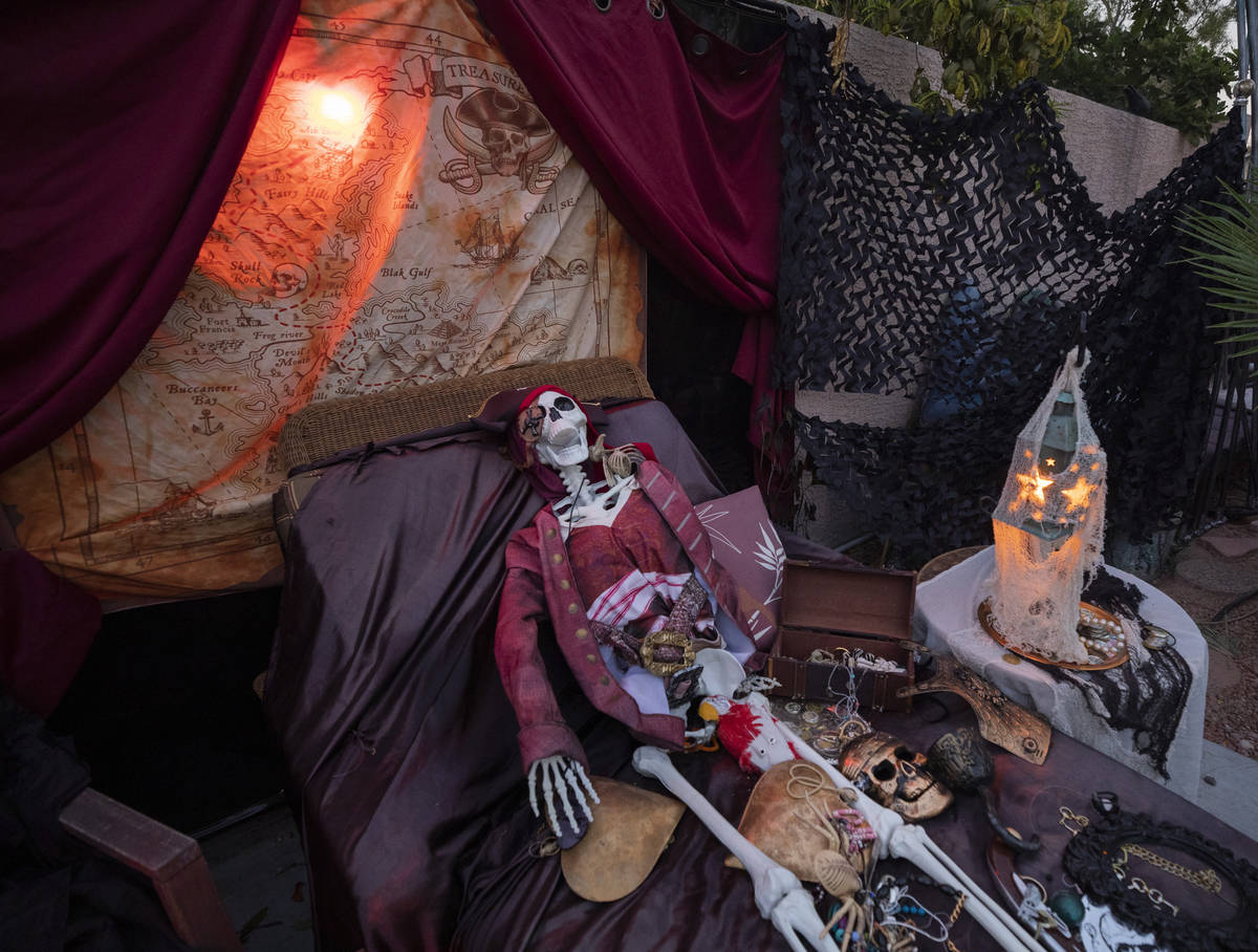 A skeleton scene from The Pirates of the Caribbean is seen in the GarciaÕs backyard for th ...