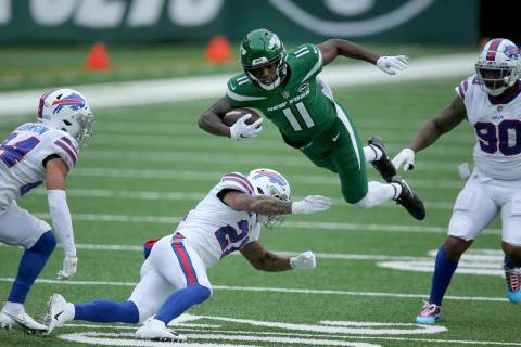 New York Jets wide receiver Denzel Mims (11) in action against Buffalo Bills safety Jordan Poye ...