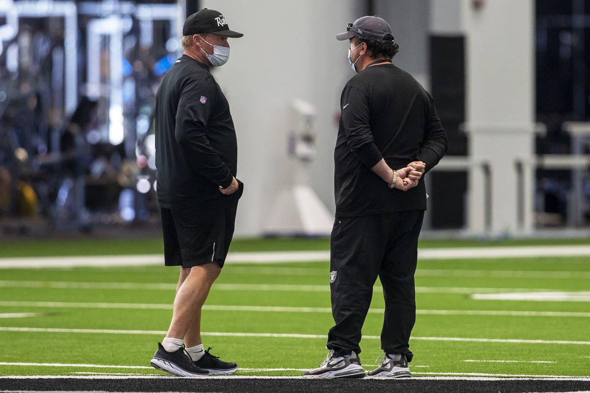 Las Vegas Raiders head coach Jon Gruden, left, and defensive coordinator Paul Guenther meet dur ...