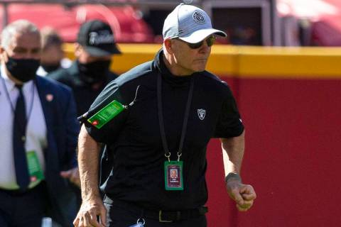 Las Vegas Raiders defensive line coach Rod Marinelli runs on the field before an NFL football g ...