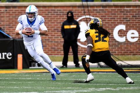 Kentucky quarterback Joey Gatewood, left, scrambles as Missouri linebacker Nick Bolton (32) def ...