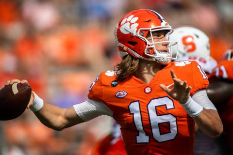 Clemson quarterback Trevor Lawrence (16) makes a pass during an NCAA college football game agai ...