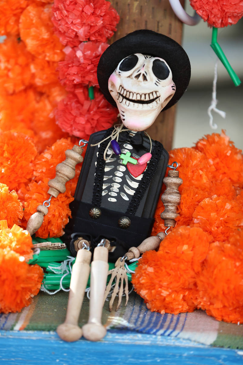 An altar doll created by Isaias Urrabazo that will be part of his Dia de los Muertos altar, at ...