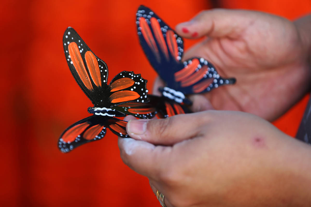 Isaias Urrabazo holds butterflies he created that will be part of his Dia de los Muertos altar, ...