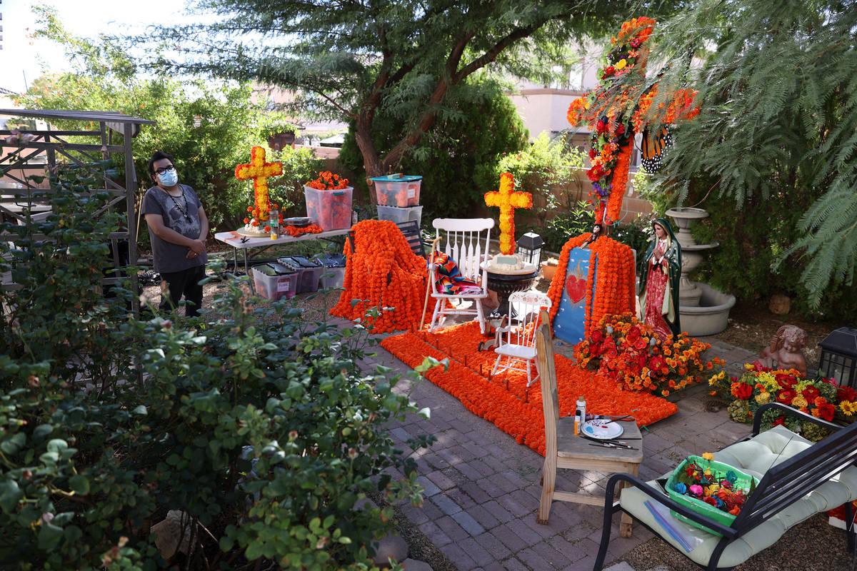Isaias Urrabazo stands next to his Dia de los Muertos altar at his home in Las Vegas, Saturday, ...