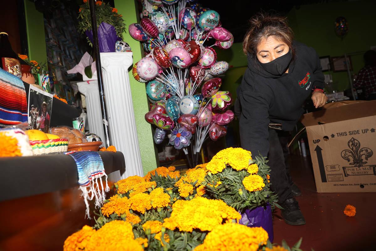 Flor Santos organizes Mexican marigold bouquets, also know as Cempasuchil, at Santos Flowers sh ...