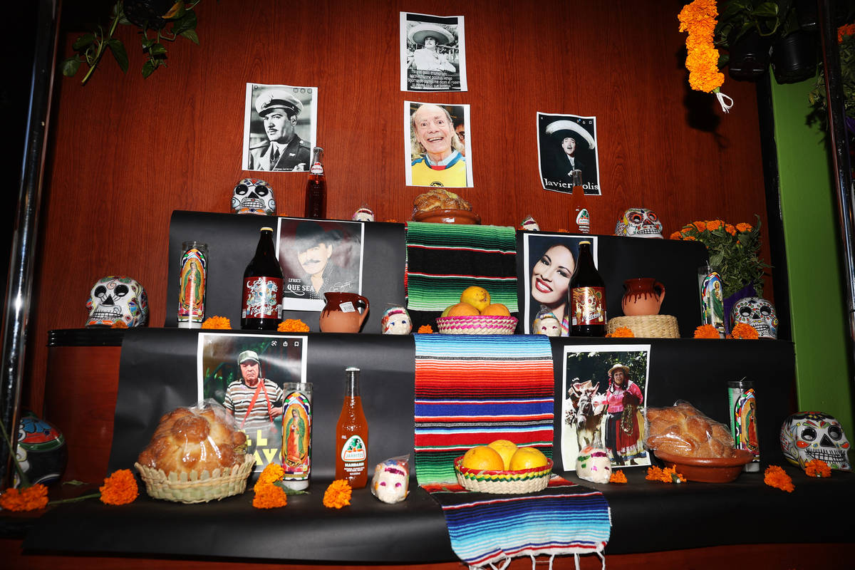 An altar with pictures of Mexican entertainers and musicians and decorated with sugar skulls, c ...