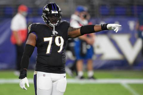 Baltimore Ravens offensive tackle Ronnie Stanley (79) points during the first half of an NFL fo ...