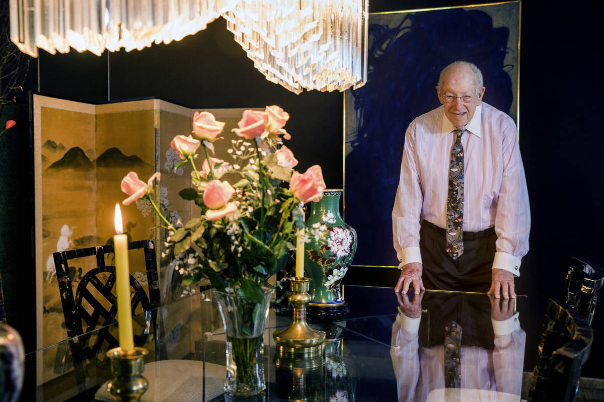 Oscar Goodman stands at the dining room table where he and his wife, Carolyn, hosted a meal for ...