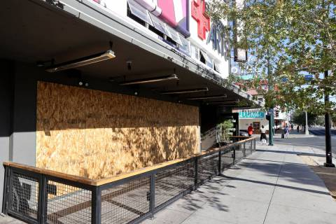 The Eureka! restaurant on East Fremont Street in downtown Las Vegas is boarded up on Election D ...