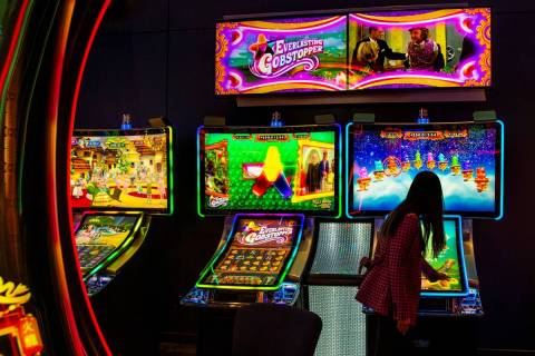 Cathryn Lai, senior vice president of product & marketing at Scientific Games, plays the game E ...