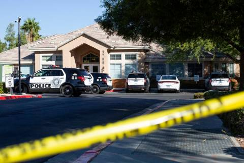 Metropolitan police investigate a homicide at the 9700 block of West Sunset Road near Fort Apac ...