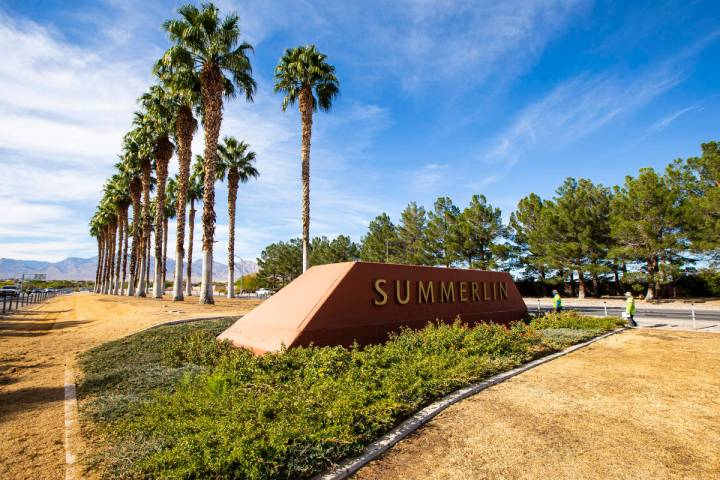New irrigation lines, left, are seen as part of a median landscaping project on Summerlin Parkw ...