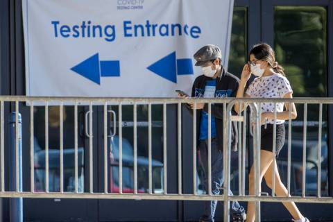 People enter the COVID-19 testing offered at Cashman Center in partnership with University Medi ...