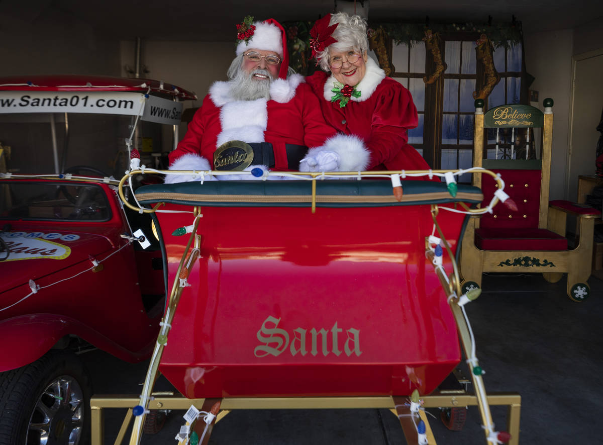 """Jean Gray, 72, as """"Santa Kris Kringle"""" and Mrs. Claus, are seen at Groeschke's home on Tuesday, ..."""
