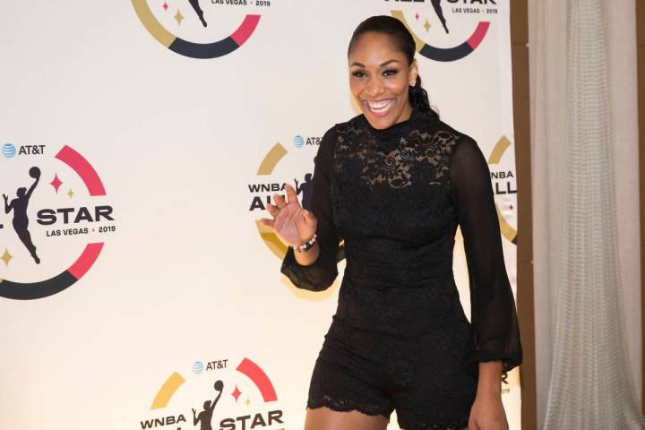 Las Vegas Aces forward A'ja Wilson waves at fans on the WNBA Orange Carpet outside Della's Kitc ...