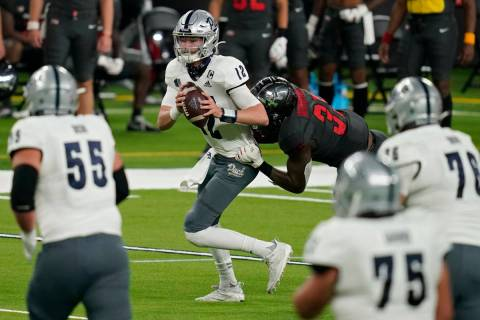 UNLV linebacker Jacoby Windmon (35) sacks Nevada quarterback Carson Strong (12) during the firs ...