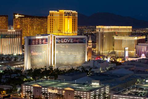 The Strip skyline lights up at dusk as seen from the VooDoo Lounge atop the Rio hotel-casino in ...