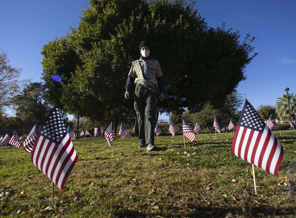 Seamus Smith, senior patrol leader of Boys Scouts of America Troop 208, walks at the Garden of ...