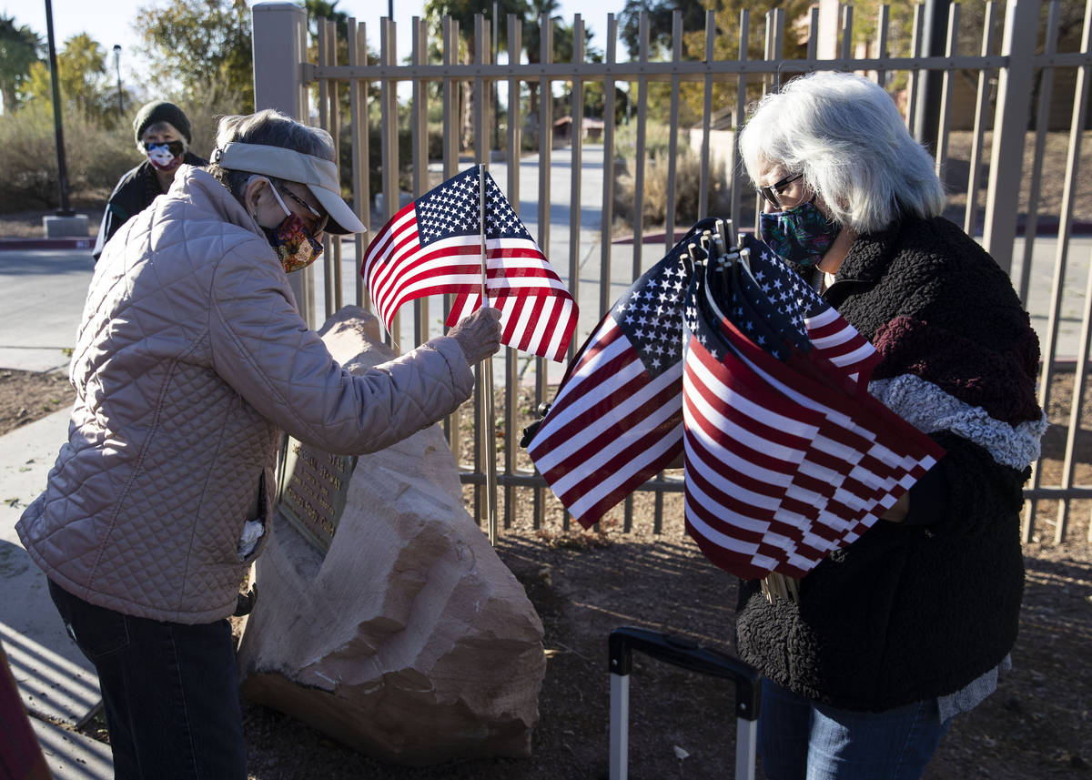 Muriel Scrivner, left, retired U.S. Air Force Sgt., and Korean War veteran, and Mary Castro, pl ...