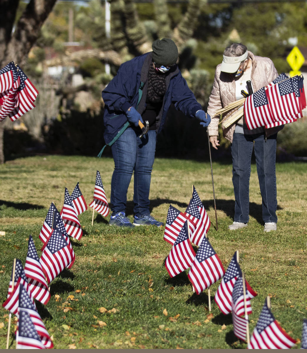 Scheela Morgan, left, and Muriel Scrivner, retired U.S. Air Force Sgt., and Korean War veteran, ...