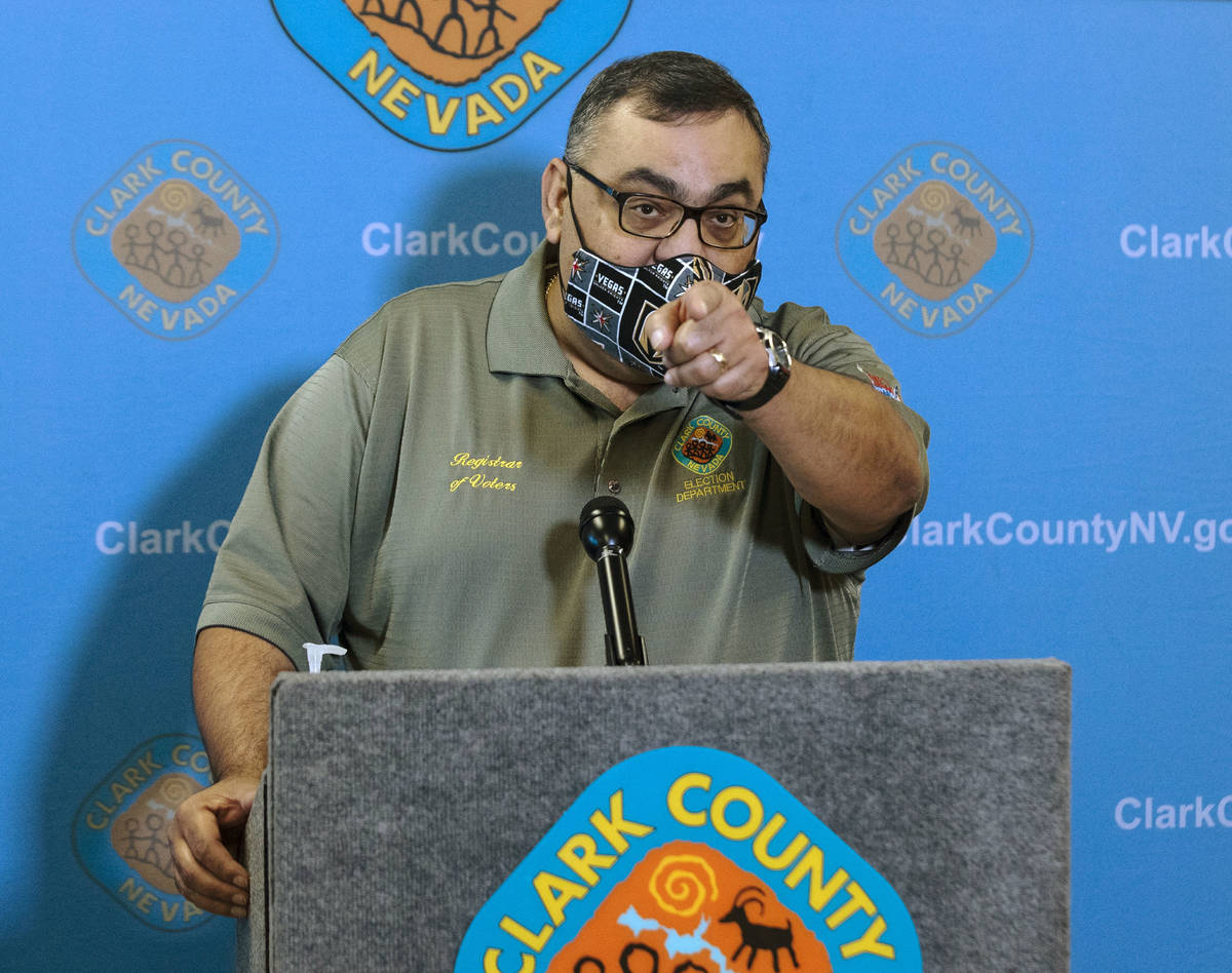Clark County Registrar, Joe Gloria, takes reporters questions as he provides an update on elect ...
