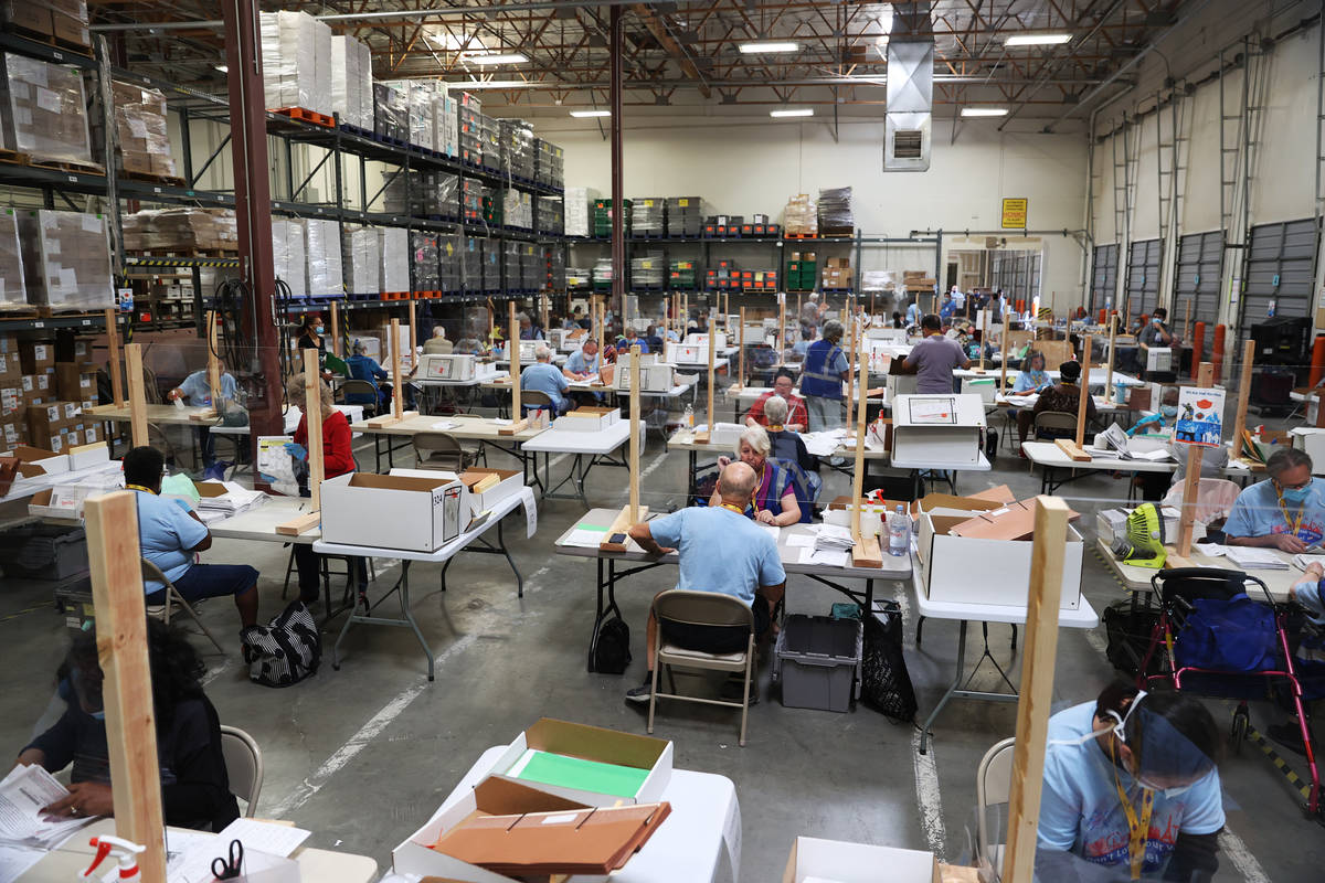 Workers count ballots at the Clark County Election Department in Henderson, Wednesday, June 10, ...