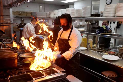 Chef Mike Minor shown cooking at Border Grill in July, has been in Las Vegas since 1982 (K.M. C ...