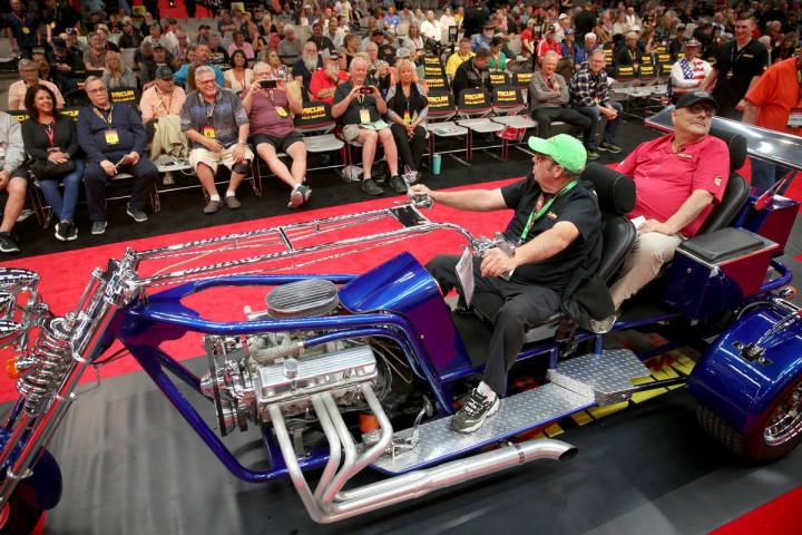 Dana Mecum, founder and president of Mecum Auctions, right takes a ride on a 2006 LV Trike cust ...