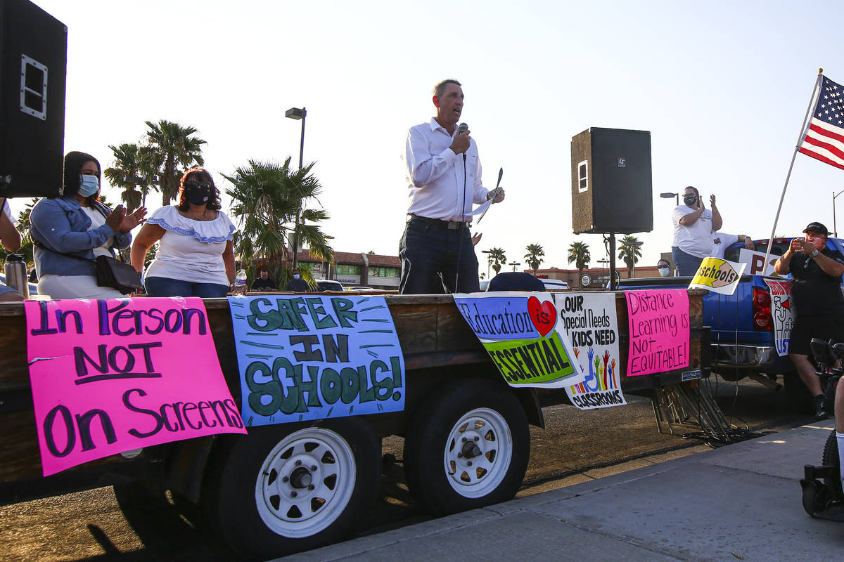 State Sen. Scott Hammond, R-Las Vegas, speaks during a demonstration in support of reopening pu ...
