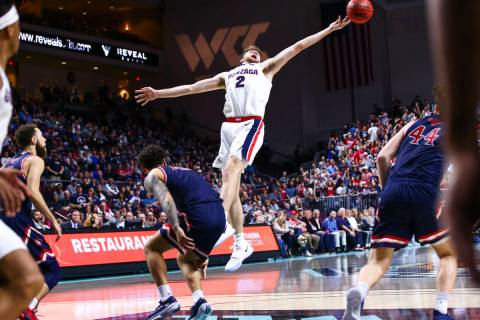 Gonzaga Bulldogs' Drew Timme (2) reaches for a rebound during the second half of the West Coast ...