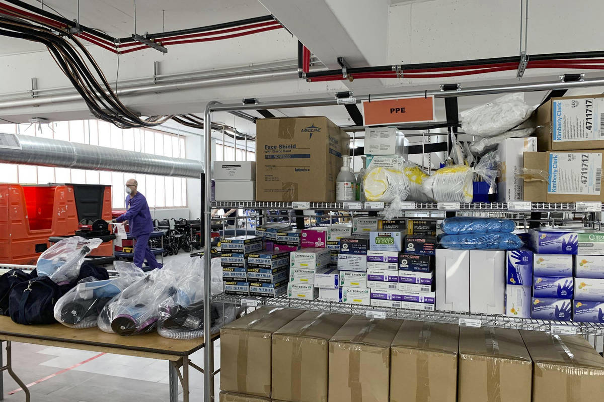 Personal protective equipment (PPE) is stacked inside Renown Regional Medical Center's parking ...
