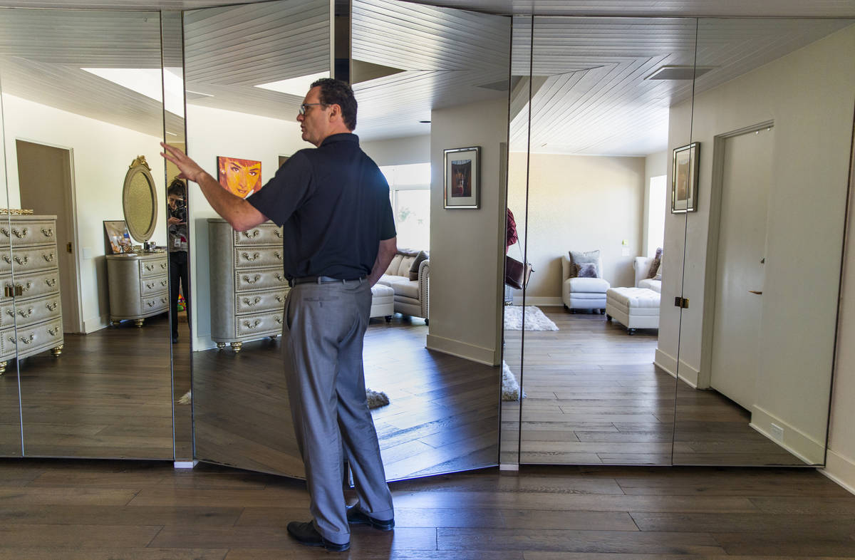 "Owner Jim Morgan in 2019 shows off the master bedroom of Frank ""Lefty"" Rosenthal's former ..."