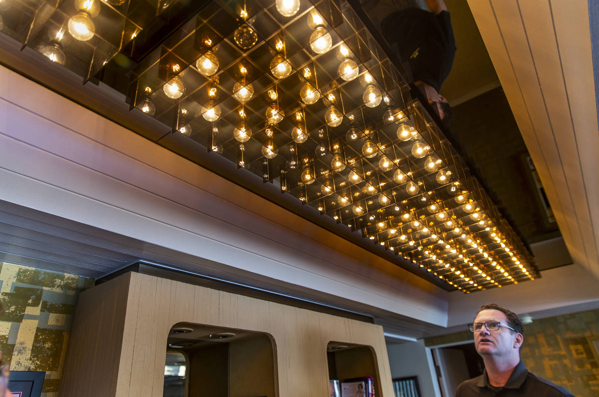 Owner Jim Morgan shows off some of the cool lighting preserved during a tour of Lefty Rosenthal ...