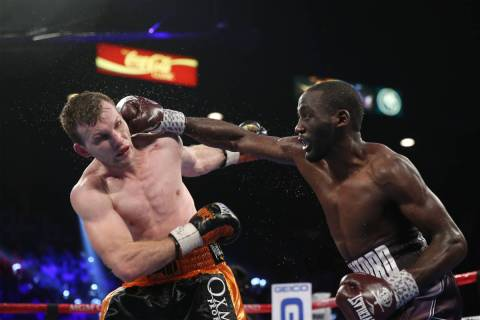 Terence Crawford, right, connects a punch against Jeff Horn in the WBO welterweight World Title ...