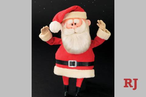 This image released by Profiles in History shows a Santa Claus puppet used in the filming of th ...