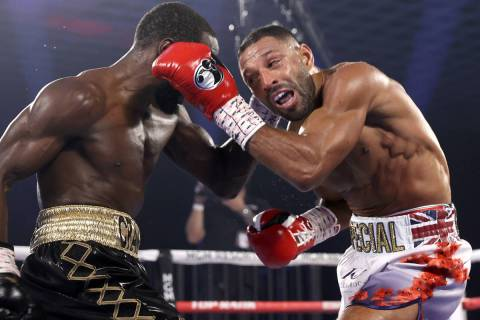 """Terence """"Bud"""" Crawford, left, and Kell Brook exchange punches during their title fight Satu ..."""