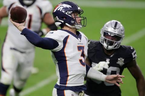 Denver Broncos quarterback Drew Lock (3) throws against against the Las Vegas Raiders during th ...